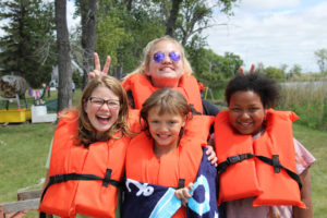 Lexy hanging out with some campers at Camp Good News.